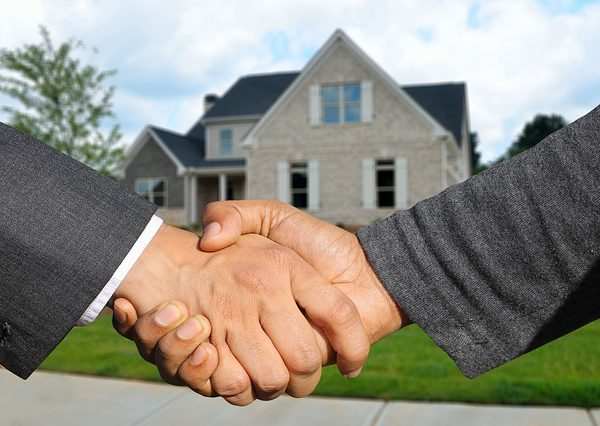 Lender and Borrower handshake to close the loan